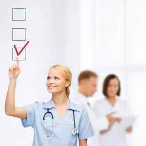 Nurse creating check list of reasons to work in the UK