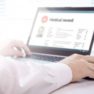 Doctor Using Laptop And Electronic Medical Record (emr) System.